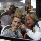 John (top) and Edward -- aka Jedward -- pictured with Irish international soccer player Olivia O'Toole on the torchbearers' bus.