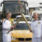 Henry Shefflin passes the Olympic Flame to Garda Brian Brunton.