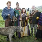 Irish historical re-enactors from 'The Tain' pose with the Olympic Torch at the border crossing.
