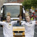 Jedward -- that's John on the left, we're told -- carry the Olympic Flame through Dublin.