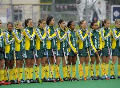 South Africa players stand as the wrong anthem is played yesterday.