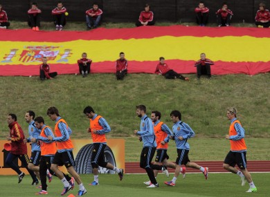 Spain's team warm up during their training session in front of Spanish flag earlier.