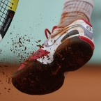 Rafa Nadal knocks the clay off his runners during his French Open quarter-final against Nicolas Almagro. (AP Photo/Christophe Ena)