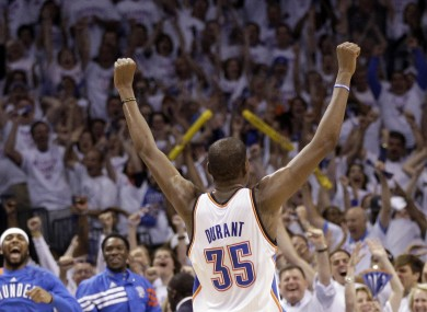 Oklahoma City Thunder small forward Kevin Durant (35) celebrates.