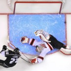 New Jersey Devils' goalie Martin Brodeur makes a save from Trevor Lewis of the Los Angeles Kings during Game Four of the Stanley Cup Finals. (AP Photo/Mark Terrill)