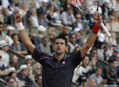 Djokovic celebrates his victory.