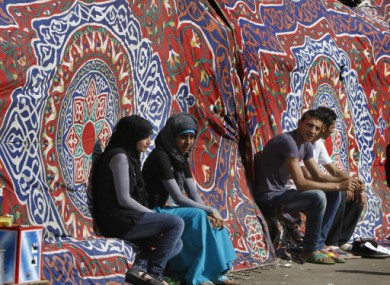Young people sitting at a traditional coloured tent at Tahrir Square, Cairo.