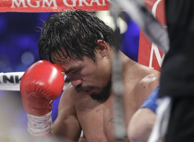 Manny Pacquiao sits in his corner following the tenth round of his WBO welterweight title fight against Timothy Bradley.