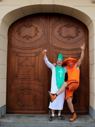 An  Ireland fan poses with a Dutch fan in the main square in Poznan yesterday.