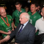 President Michael D Higgins meets Irish football fans as he arrived to meet the Irish Team in Poznan