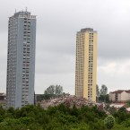 A sequence of pictures showing the demolition by the use of controlled explosives of the multi-storey block at 153-213 Petershill Drive in Glasgow, Scotland.