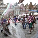 Croatian soccer fans are seen through a soap bubble in the fan zone during the Euro 2012 soccer championship in Poznan, Poland, Sunday, June 10, 2012. (AP Photo/Darko Bandic)