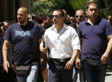Ilias Kasidiaris, centre, pictured with other Golden Dawn members at the prosecutor's office in Athens.