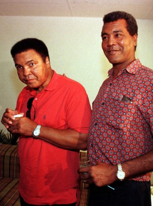 Stevenson, right, with Muhammad Ali in 1998.