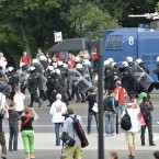 Police bring a water cannon as fan clashes prior to the Euro 2012 soccer championship Group A match between Poland and Russia in Warsaw, Poland, Tuesday, June 12, 2012. Russian soccer fans clashed with police and Poland supporters in separate incidents in Warsaw on Tuesday, just hours before the two teams were to meet in an emotionally charged European Championship match. Several people were injured. (AP Photo/Alik Keplicz)