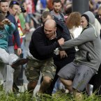 Fans clash prior to the Euro 2012 soccer championship Group A match between Poland and Russia in Warsaw, Poland, Tuesday, June 12, 2012. (AP Photo/Gero Breloer)