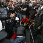 Polish riot police tend to a Russian soccer fan, Russia played Poland in their Euro 2012 Group A soccer tournament in during the  Euro 2012 soccer championship in Wardsaw, Poland , Tuesday, June 12, 2012. (AP Photo/Czarek Sokolowski)