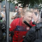 A Polish soccer fan argues with police prior to the Euro 2012 group A soccer match between Poland and Russia in Warsaw, Poland , Tuesday, June 12, 2012. (AP Photo/Czarek Sokolowski)