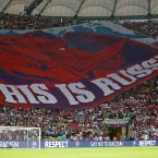 Russian fans display a huge banner the Euro 2012 soccer championship Group A match between Poland and Russia in Warsaw, Poland, Tuesday, June 12, 2012. (AP Photo/Matt Dunham)