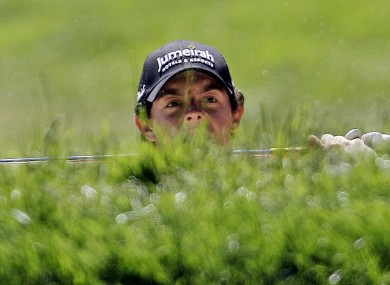 McIlroy hits out of a bunker on the 12th hole during a practice round.