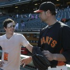 Rory gets some tips from Giants pitcher Ryan Vogelsong before the game...