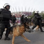 Polish police stand guard outside the stadium before the Euro 2012 soccer championship Group A match between Poland and Russia in Warsaw, Poland, Tuesday, June 12, 2012. (AP Photo/Gero Breloer)