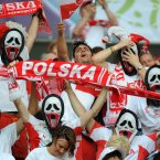Polish fans in masks in the stadium before the match