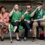 Irish fans drink beer while sitting on a bench with a Polish woman ahead of the Euro 2012 soccer championship Group C match between Ireland and Spain in Gdansk, Poland , Thursday, June 14, 2012. (AP Photo/Peter Morrison)