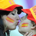 Spain fans show support for their team and kiss before kick-off in the stands