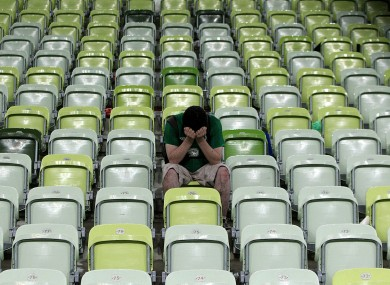 An Ireland fan dejected after the final whistle.
