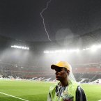 Lightning strikes during the Euro 2012 soccer championship Group D match between Ukraine and France in Donetsk, Ukraine, Friday, June 15, 2012. The match was suspended due to heavy rain. (AP Photo/Manu Fernandez)
