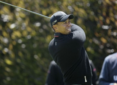 Tiger Woods had started the day three strokes behind Michael Thompson.