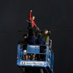 Nik Wallenda pumps his fist as he completes his 1,800ft-long tightrope walk (AP Photo/The Canadian Press, Aaron Vincent Elkaim)
