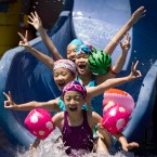Chinese children play on a pool at a park during summer in Beijing. (AP Photo/Andy Wong)