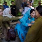 Indian policewomen detain a Kashmiri government employee protesting against the government in Srinagar. The employees demanded the government compensate them for unpaid salaries and raise the retirement age. (AP Photo/Dar Yasin)