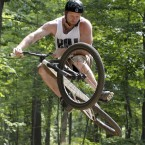 Jon Smith of Brentwood twists his bike as he gets some air going over a jump at the Skills Park at the North Park Free Ride Area in Allison Park, Pa. Smith says he has been coming to the spot at the Allegheny County Park north of Pittsburgh since he found out about it at the end of Summer in 2011. (AP Photo/Keith Srakocic)
