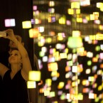 A woman takes photos inside an installation aimed to educate visitors about nature at the TEDXRio+20 forum in Rio de Janeiro. TEDXRio+20 aims to help people understand man's capacity to destroy, but above all to help visitors understand how to build a new and sustainable way of life. The event is parallel to the UN Conference on Sustainable Development, or Rio+20. (AP Photo/Silvia Izquierdo)