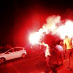 Greek fans celebrate in downtown of Thessaloniki.