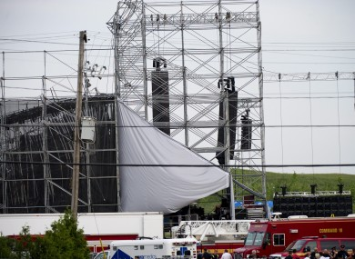 Emergency workers around the collapsed stage after the accident