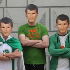 Republic of Ireland fans (left to right) Mark Killian, Feidhlim Lenehan and Paul Leonard wear Roy Keane masks in the main square in Poznan, Poland.