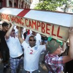 England fans make a protest against Sol Campbell's advice not to travel to the Ukraine or they could go home in a coffin, by taking a coffin to the Golden Lion in Donetsk, Ukraine, ahead of the England v Ukraine Euro 2012 football match.