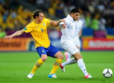 Sweden's Kim Kallstrom (left) and France's Hatem Ben Arfa battle for the ball.