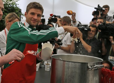 Germany's Thomas Muller cooks a Risotto during a press conference. As you do. 