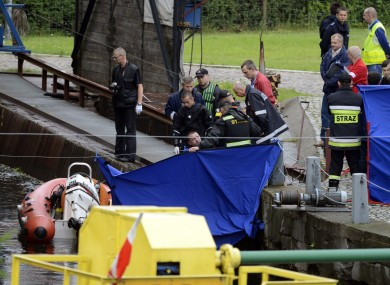 Police divers retrieve the body of James Nolan from a canal in Bydgoszcz yesterday. The body was officially identified by his family last night.