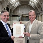 Dr John Martin receives a letter sent from the Titanic, from Bryan Gregory, acting chief executive of the Titanic Foundation, in the old drawing rooms at Harland and Wolff.