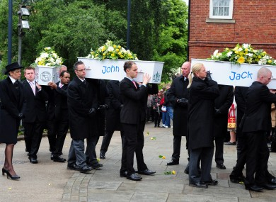 Coffins being carried into St Mary's Church in Derby this morning