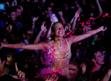 A reveler at a glow paint party in Spain early this morning
