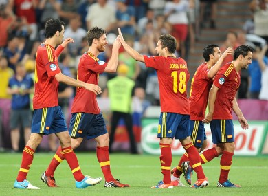 The Spanish players celebrate Alonso's second goal.
