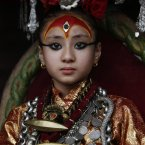 Nepal's living goddess locally known as Kumari, Samita Bajracharya, watches the last day of Rato Machhendranath chariot festival in Patan, outskirts of Katmandu, Nepal. (AP Photo/Binod Joshi)