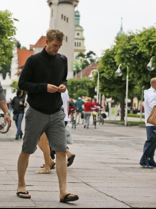 Germany defender Per Mertesacker walks through Sopot town centre.